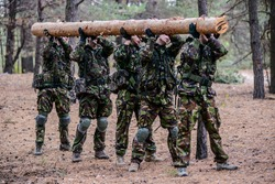 Outdoor workout in forest.Group of soldiers.