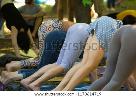 Outdoor yoga training for beginners. Women in yoga pose