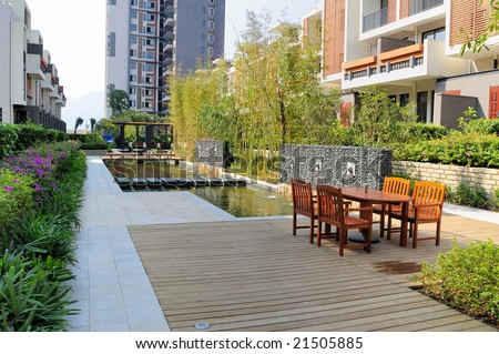 Outdoors landscape with resting chairs and fountain and tree in a new residential district