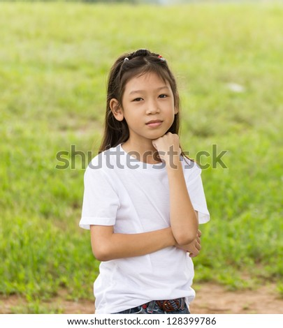 Outdoors portrait of beautiful Asian young girl