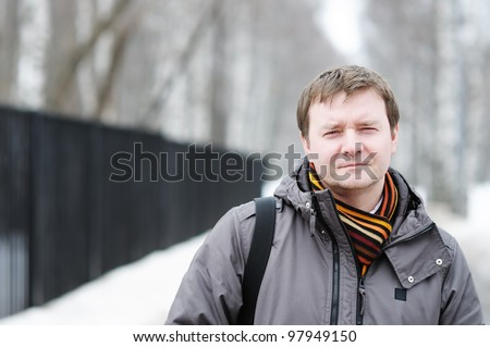 Outdoors portrait of courageous middle age man