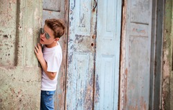 Outdoors portrait of cute boy in a city of old Havana