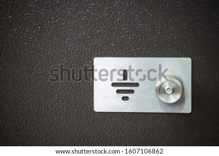 Outer side of housing for electric relay with grounding place made of stainless steel with bolt and round nut for cable clamp