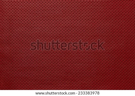 outer side of texture of leather fabric of red color for pure backgrounds with the punched openings