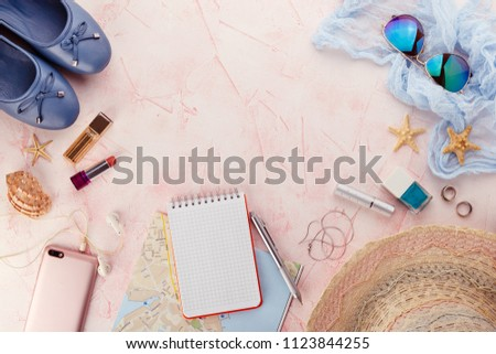 Outfit and accessories of traveler on pink background with copy space, Travel concept. #1123844255