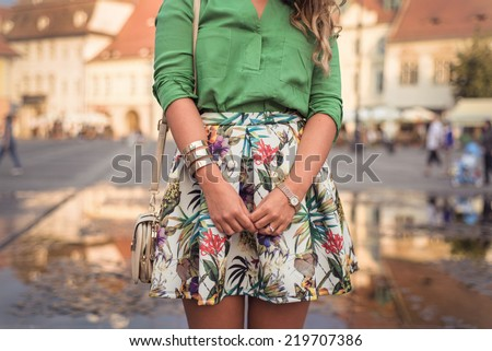 Shutterstock Outfit details of fashion elegant stylish woman posing on city streets in summer evening weather. Sensual blonde vogue girl street style shooting