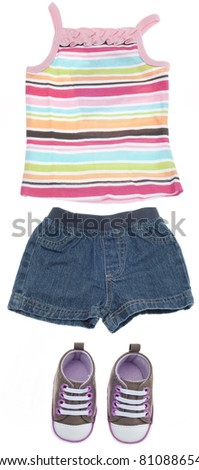 Outfit for a Girl Child Including Tank Top, Shorts and Sneakers Isolated on White with a Clipping Path.