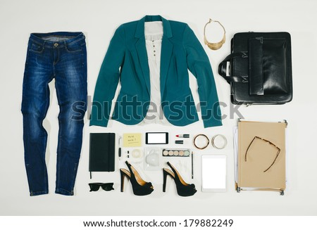 Shutterstock Outfit of clothes and woman accessories./ Overhead of essentials business woman.