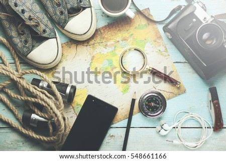 Outfit of traveler on the wooden background - Shutterstock ID 548661166