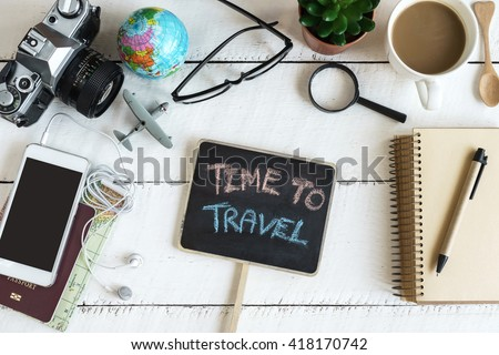 Outfit of traveler on white wooden background and copy space, Travel concept