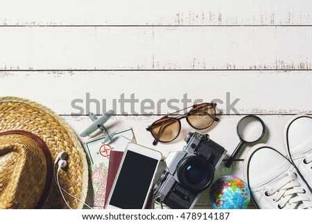 Outfits and accessories of traveler on wooden background, Summer and Travel concept #478914187