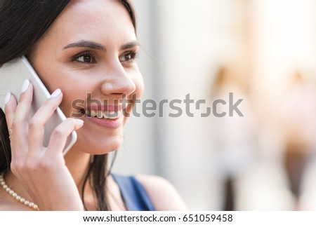 Outgoing woman telling by phone #651059458