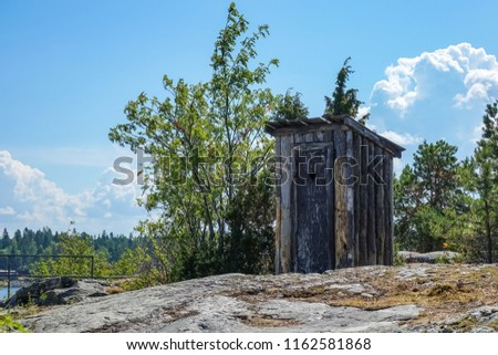 Outhouse, outdoor toilet on a cliff in archipelago landscape.