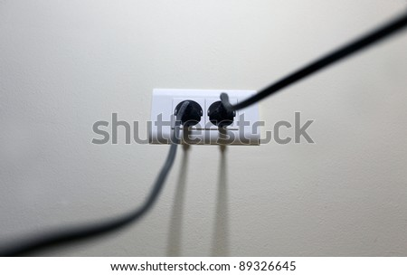 Outlet in wall - stock photo