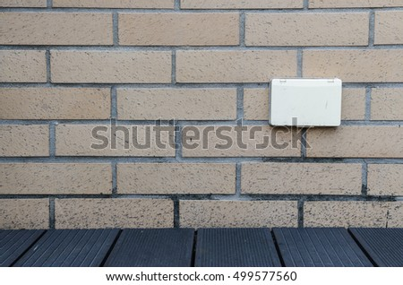 Outlet white Brown on the wall beside the pool. #499577560