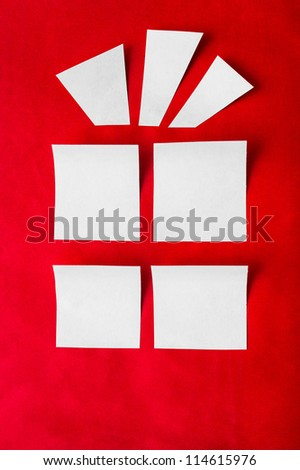 outline a Christmas gift of a white paper on a red background