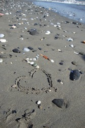 Outline of a hearth in a stony beach at the sea