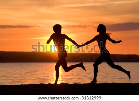 Outlines of happy guy and girl running down seashore at sunset - stock    Girl Running Away From Guy