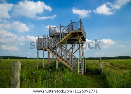 Outlook overlook tower stairs watchtower field grass deer stand wildlife viewing platform