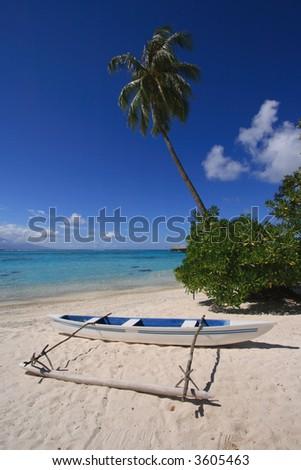 Outrigger canoe on tropical beach in Tahiti