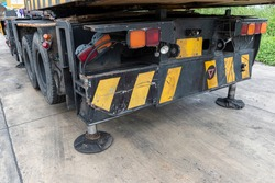 Outrigger mobile crane for heavy duty construction side. Hydraulic supports for the crane legs.