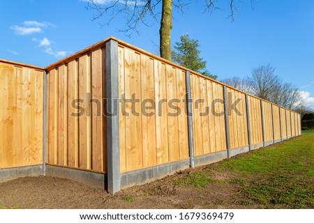 Outside built new wooden fence construction surrounding dutch garden Foto d'archivio ©
