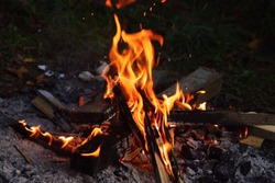 Outside burning fire. A barbecue cap fire from wood.