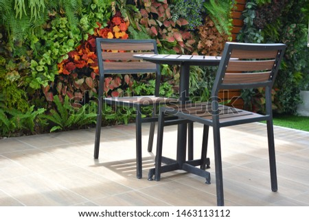 Outside coffee shop. Outside coffee table set over nature garden background.