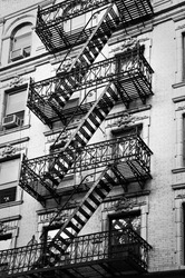 Outside metal fire escape stairs, New York City, USA
