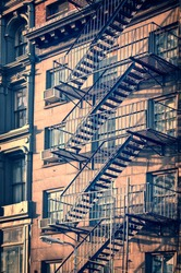 Outside metal fire escape stairs, New York City, vintage process