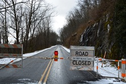 Outside of Asheville NC barricades block access to the Blue Ridge Parkway on a section that is closed to traffic in the winter