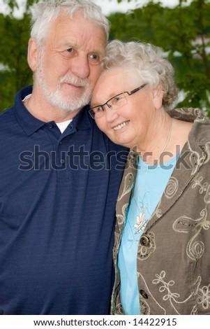 outside portrait of an elderly couple enjoying each others company