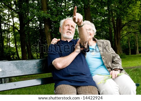 outside portrait of an elderly couple on a bench