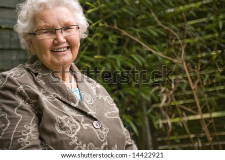outside portrait of an elderly woman smiling
