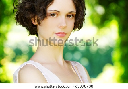 outside portrait of young beautiful brunette woman with fresh and clean skin