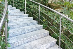 Outside Stairs With Marble Stone Steps.Winding Staircase With Marble Steps. Stairs With Stainless Steel Railing Or Handrail. Outdoor  Staircase In Garden Or Park. Outside Stairs With Marble Stone Step