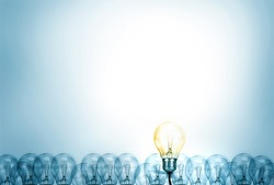 Outstanding creative idea background concept . one Light bulb glowing among a group light bulbs.