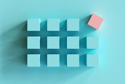 outstanding pink box among blue boxes on blue background. minimal flat lay contept