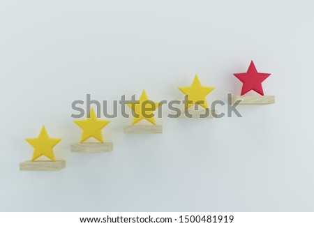Outstanding red star shape on wooden sticks. The best excellent business services rating customer experience concept Stock fotó ©