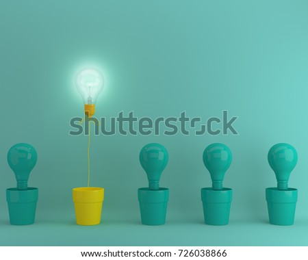 Outstanding yellow light bulbs with glowing in flowerpot one different idea from light bulbs the others on green pastel background, Minimal concept idea. #726038866