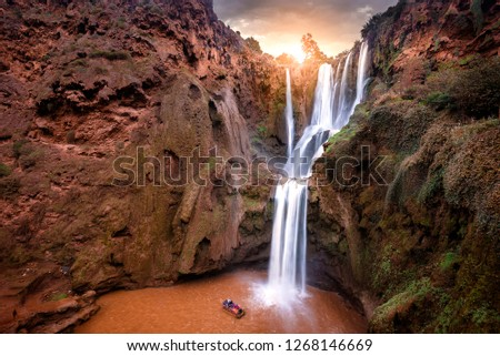 Ouzoud Waterfalls ( Cascades d'Ouzoud ) located in the Grand Atlas village of Tanaghmeilt, in the Azilal province in Morocco, Africa. Morocco's highest waterfall, and the falls at autumn color sunset #1268146669
