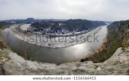 Oval turn of Elbe river in Elbe Valley, Germany, Dresden. Breathtaking panorama view from Bastei rock formation and sandstone mountains on Dresden and river in winter