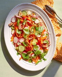 Oval Whit platter of summer salad with fresh vegetable and ingredients