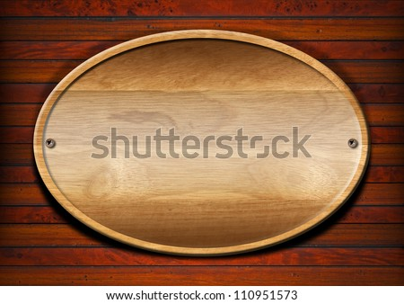 Oval Wood Board on Wall Wooden plate on wooden and old vintage background