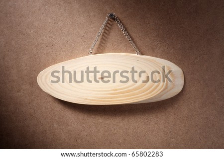 Oval wooden sign isolated on white background.