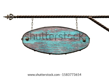 Oval wooden signboard. An old ragged blue blue wooden shopping sign hanging from text hangs on a wrought iron structure. Template is isolated on white. Blank for creativity and design.