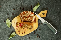 Oven-baked chicken meatloaf with papriko and spicy spices on a plate with a knife