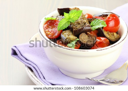 Oven baked eggplant salad with cherry tomatoes and fresh mint