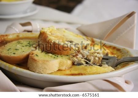 Oven baked lasagna dish with garlic bread