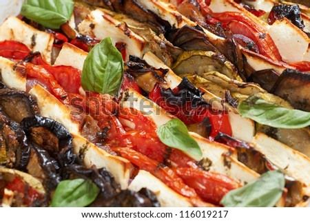 Oven-baked mediterranean french gourmet dish with vegetables and camembert cheese